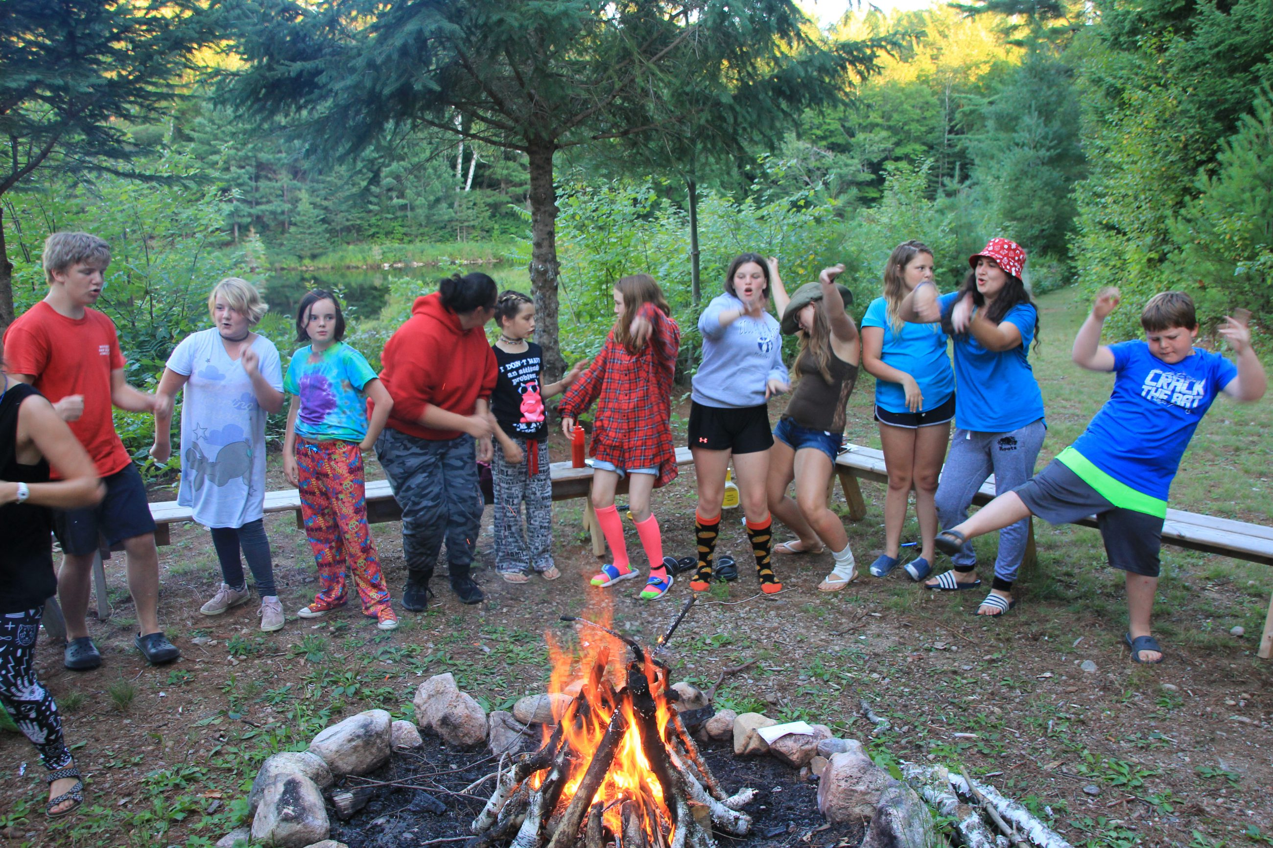 Campers having fun around the campfire.